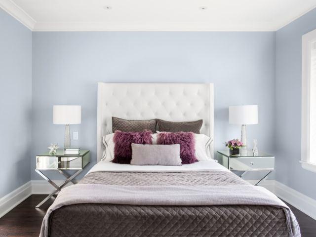 Comfortable bed in modern-looking bedroom