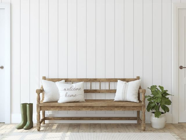 Rustic bench with throw pillows