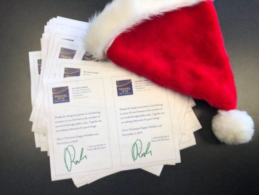 signed letters from Rick Steves and a santa hat
