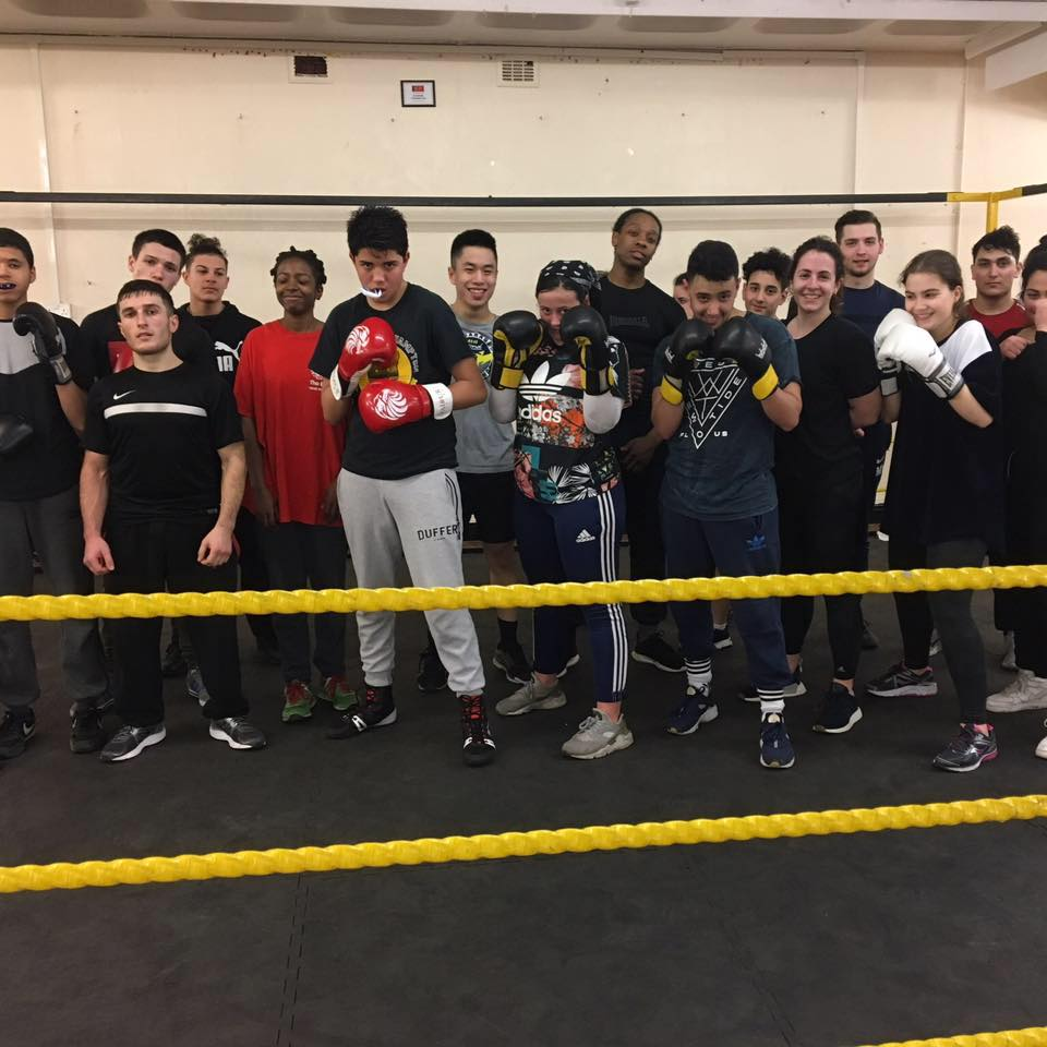Members of the boxing club pose for a photo
