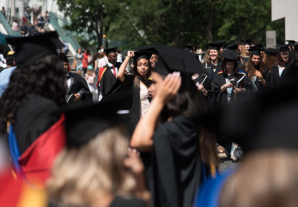 Graduates prepare to throw their hats