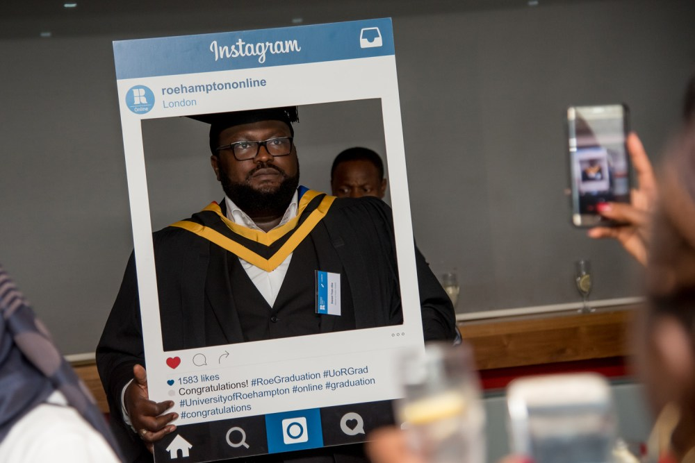An unhappy graduate poses for Instagram