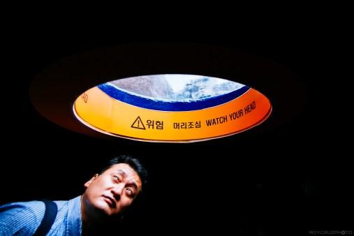 A man peeks into a viewing dome at the Hanhwa Aqua Planet Aquarium, Yeosu. Fuji X-E1, Samyang 12mm