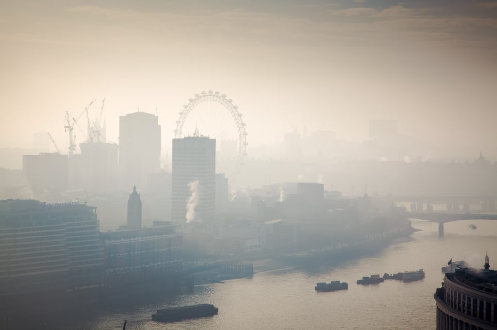 An urban landscape image of London looking smoggy