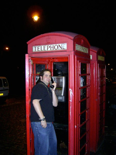 """Oh! I NEED a photo of me in one of those…"" he slurred while stuffing the digital camera in the hands of Justin and stumbling towards the phone booth."