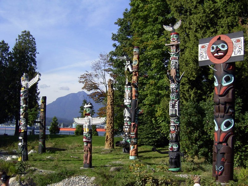 A collection of totem poles -- a good indicator you're on the West Coast