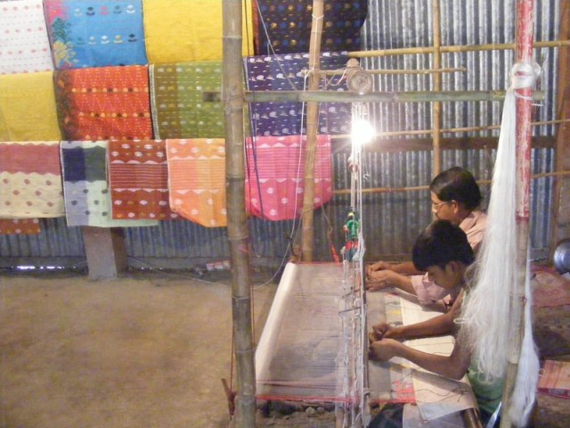 An authentic Jamdani loom with two weavers sitting alongside each other Image credit: