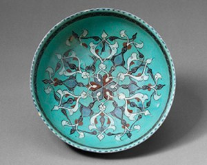 Bowl, Iran, late 12th–early 13th century. Fritware with opaque turquoise glaze and over-painted decoration. 35-31/4