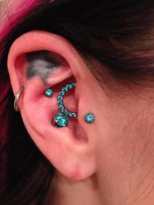 daith piercing with gem cluster by Luis Garcia