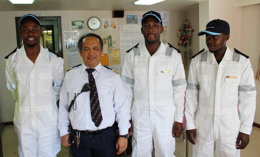 MAKING HISTORY: (From Left) Samkelo Ndongeni (25) a deck cadet from Ngqushwa near King Williams Town, Thembani Mazingi (24) an engine cadet from Cofimvaba, and Gordon Sekatang (26), also an engine cadet from Nelspruit in Mpumalanga, with the Cape Orchid skipper, Captain Edgardo De Asis prior to departure Friday with a trade cargo destined for Asian markets. The trio will remain with the ship for at least six months.