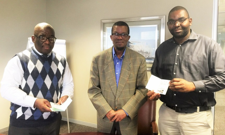 HOLDING STANDARDS: (From Left) South African Maritime Safety Authority (SAMSA) CEO, Commander Tsietsi Mokhele, Register of Seafarers Mr Peace Moeketsi and Chief Examiner Captain Azwimbavhi Mulaudzi displaying the new seafarers' certificate now in use since May 2016.