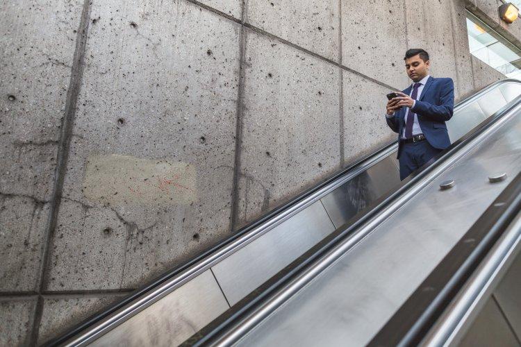 businessman-on-escalator_4460x4460