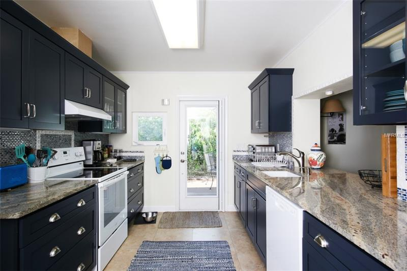 Spacious kitchen interior with new appliances.