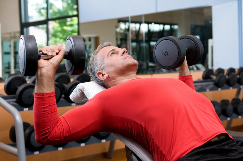 lifting weights at a fitness center at a sarasota golf course community