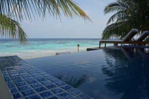 An infinity pool with an oceanside view