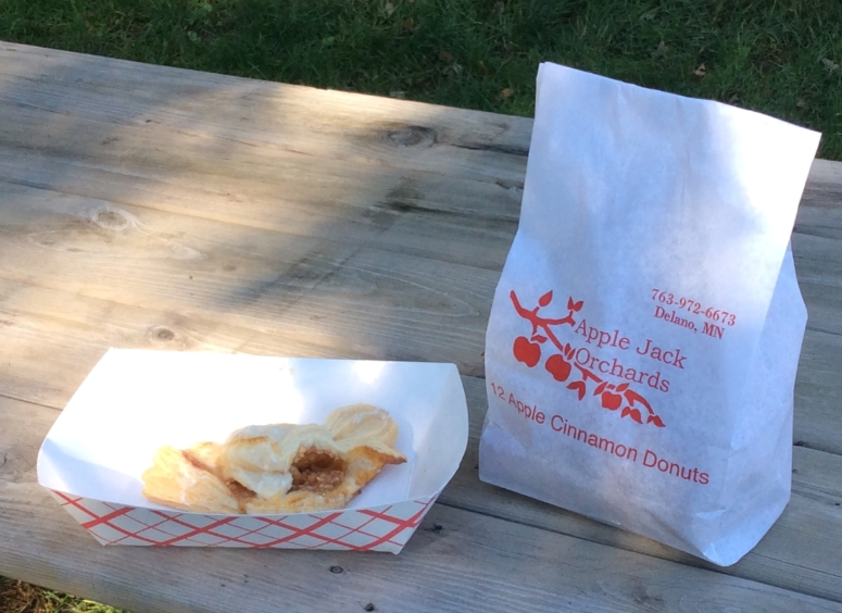 Indulging in a little apple turnover treat at the apple orchard