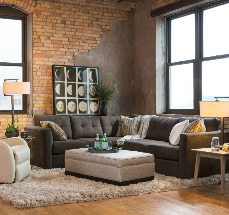 Love this relaxed modern loft space with brick walls, warm gray sectional, plush neutral area rug. From the post How to Decorate When You're Indecisive - 5 Tips - Schneiderman's {the blog}.