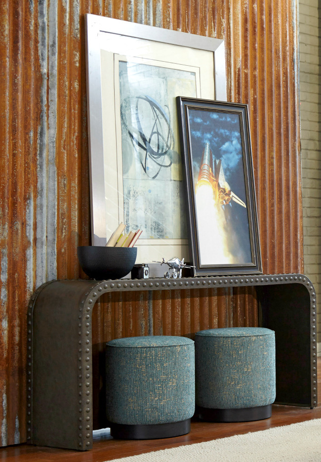 Tuck two ottomans under a console table in the foyer for extra function