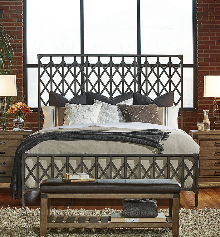 A great look in this industrial chic bedroom. We love the metal bed inspired by elevator doors, brick walls, aged wood floors