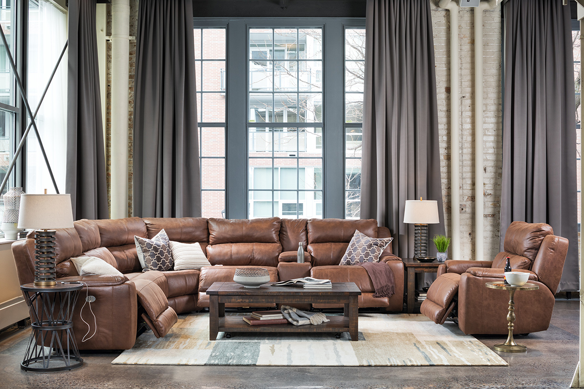 Lot family room space with reclining sofa plus recliner. Mixing materials and textures makes this neutral space interesting.