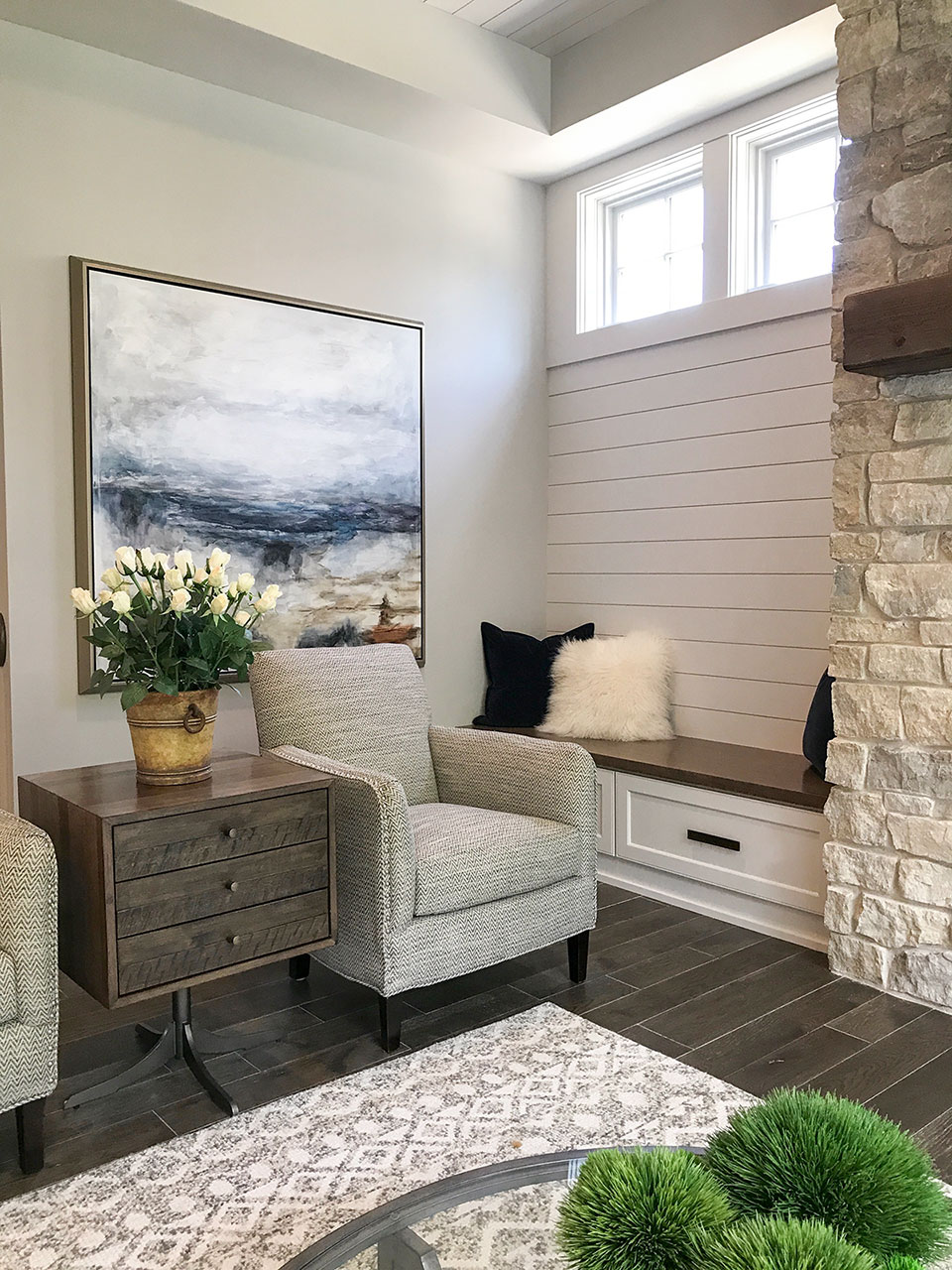 Artisan home tour living room with shiplap ceiling and walls, neutrals with blue accents, clerestory windows, cultured stone fireplace