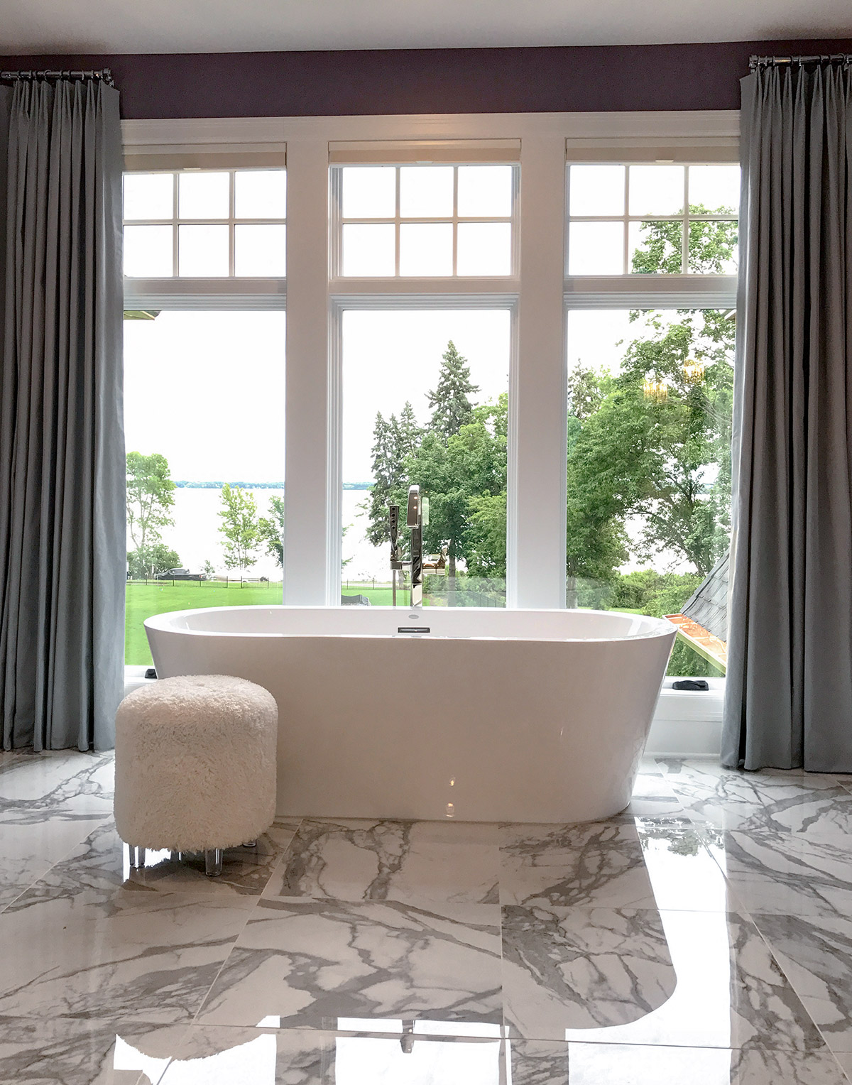 Artisan Home tour master bath with marble floors and freestanding tub