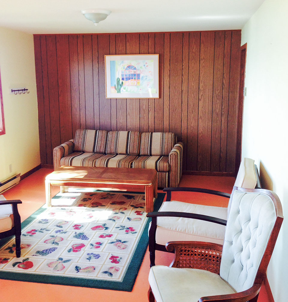 70's bedroom before makeover with old paneling and painted floors