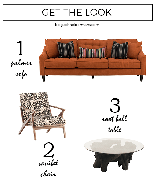 Fun, cheerful modern living room with orange tufted sofa, graphic print chair, root ball table. Shop the look!