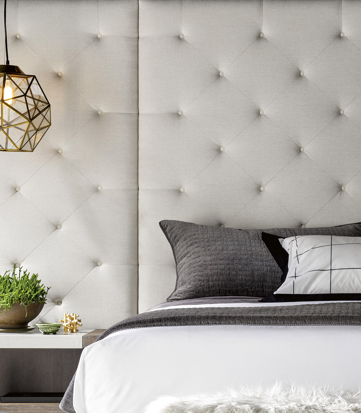 summer home - cool, calm, and collected master bedroom with white tufted headboard