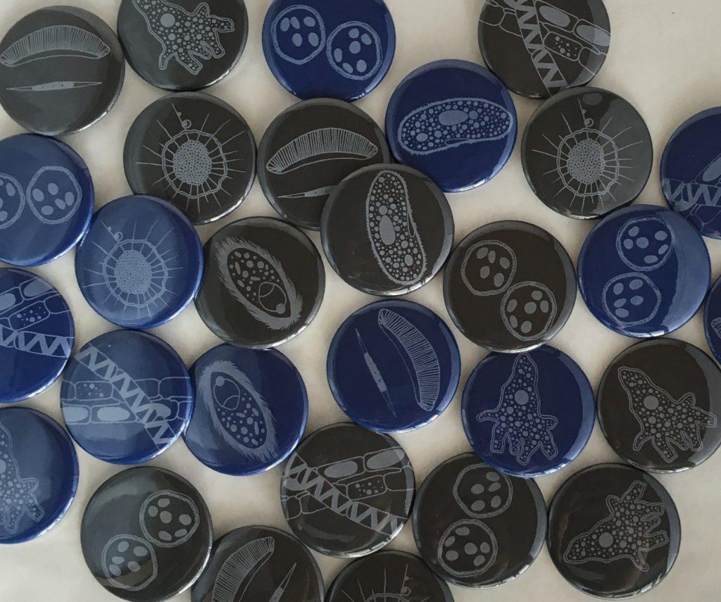 Microbe pinback buttons by Nicole Edmond