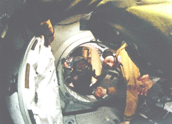 Astronaut Thomas P. Stafford (in foreground) and Cosmonaut Alexey A. Leonov make their historic handshake in space on July 17, 1975.