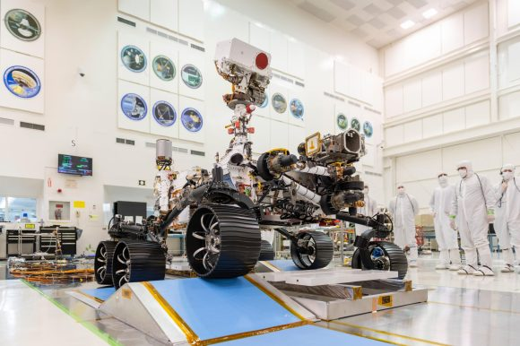 Image showing Mars rover in one of NASA's laboratories with engineers