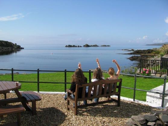 Whisky tasting in the sun at Laphroaig, Islay. Photo: Scotch Whisky Experience team