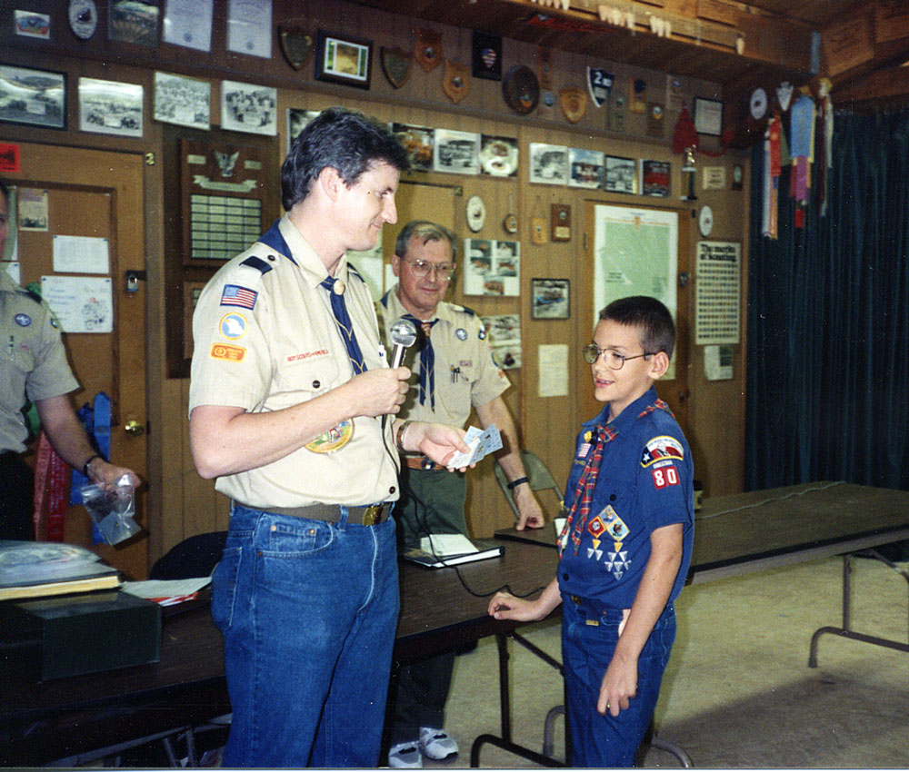 Austin Tice receives the Arrow of Light Award from his dad, Pack 80 Cubmaster Marc Tice.