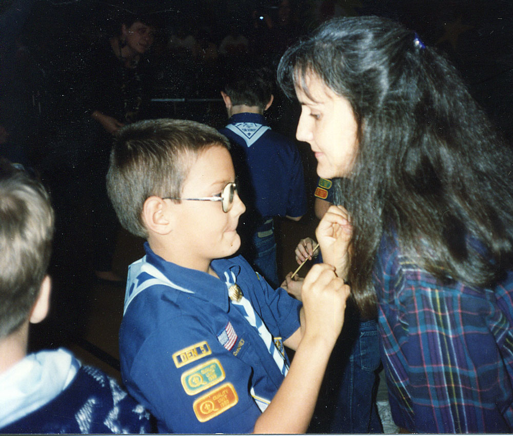 Cub Scout Austin presents his mom, Debra, with a mother's pin.