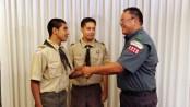 Scout-handshake-left-hand