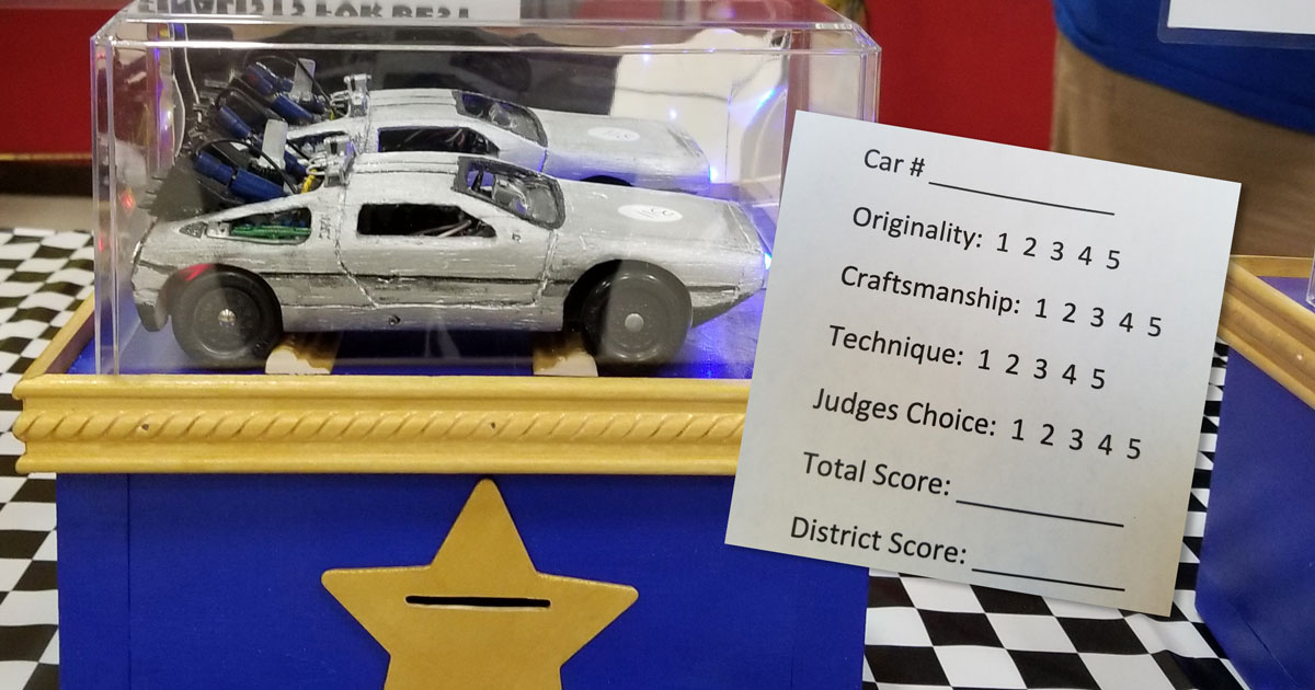 Volunteers invent an ingenious method of Pinewood Derby car judging