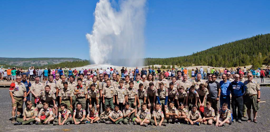 Troop 1776 pose in front of Old Faithful