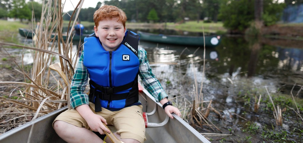 Cub Scout in canoe