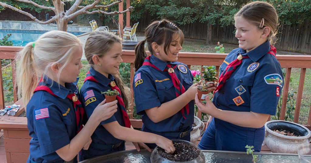 Cub Scout girls working on a project