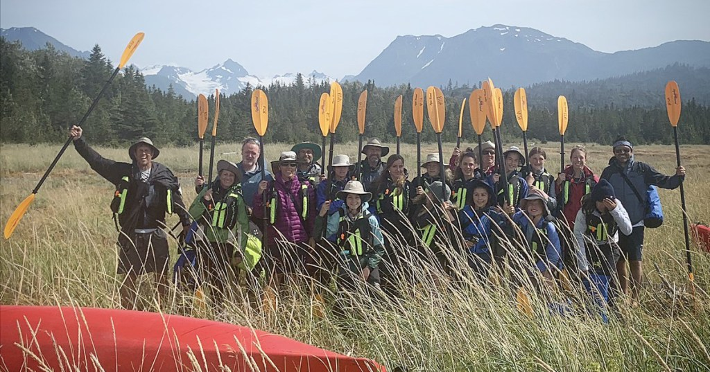 Scouts raise their paddles