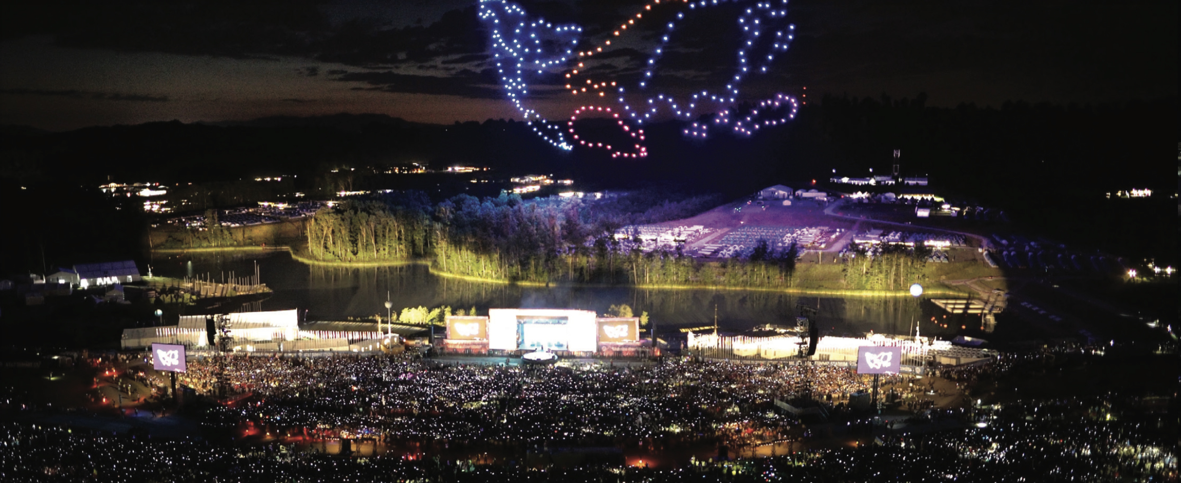 A swarm of 250 drones lights up the night sky.