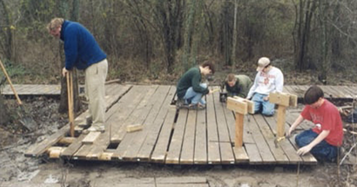 Scouts working on a deck.