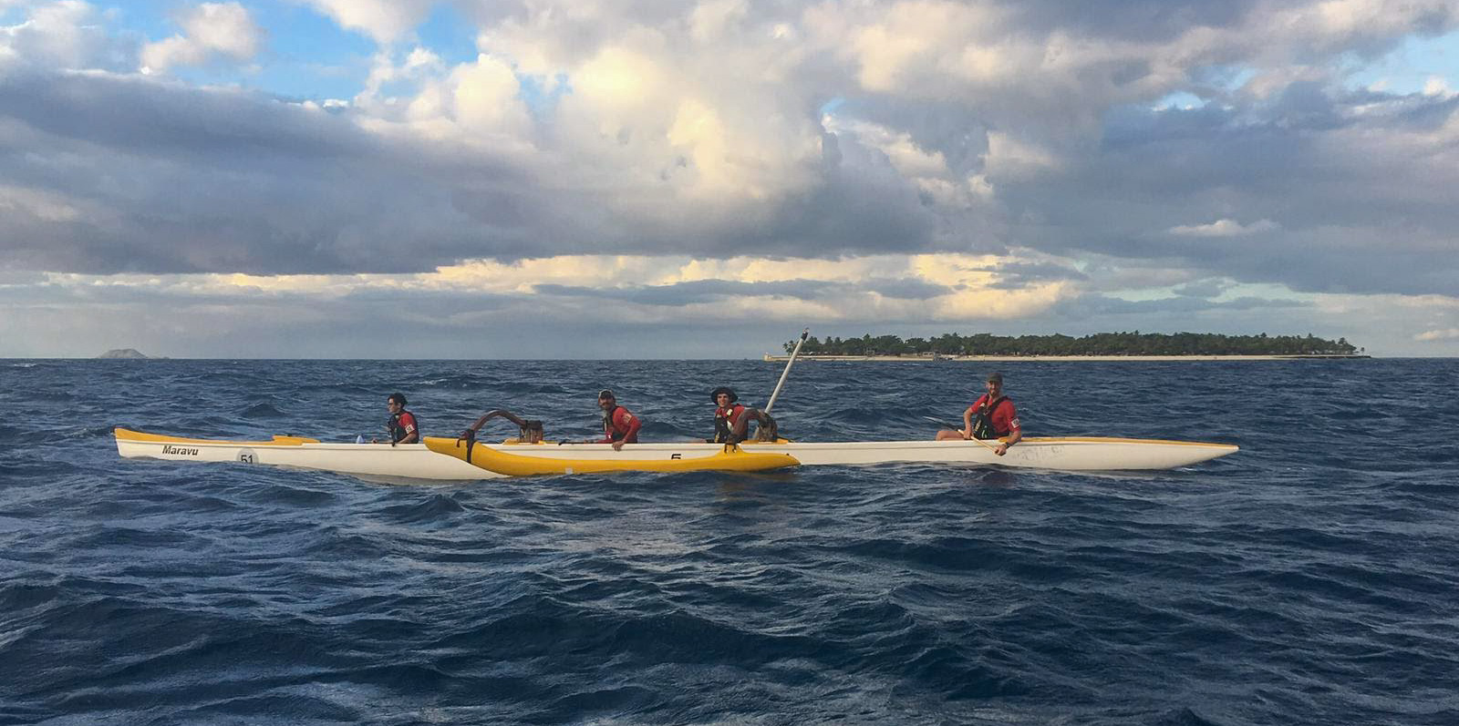 Team Eagle Scouts paddles an outrigger canoe.