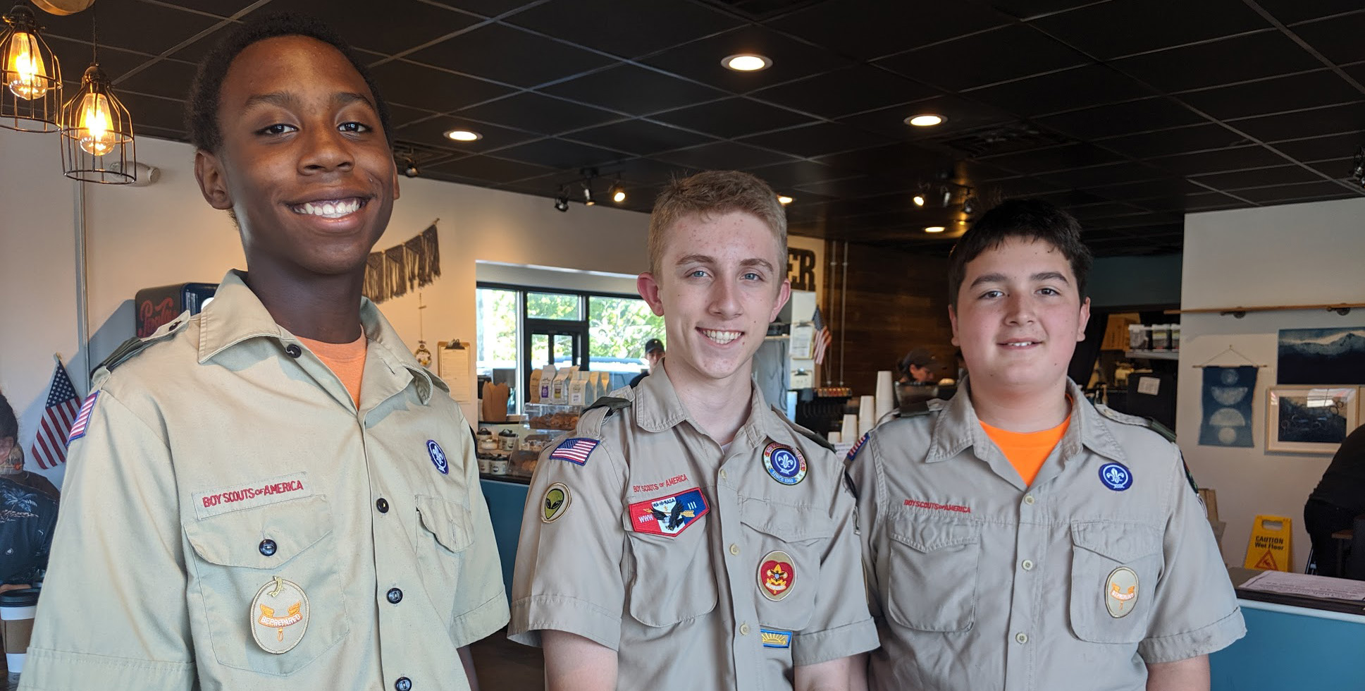 Austin (middle) and two of his helpers during the collection day at Caliber Coffee in September 2019.