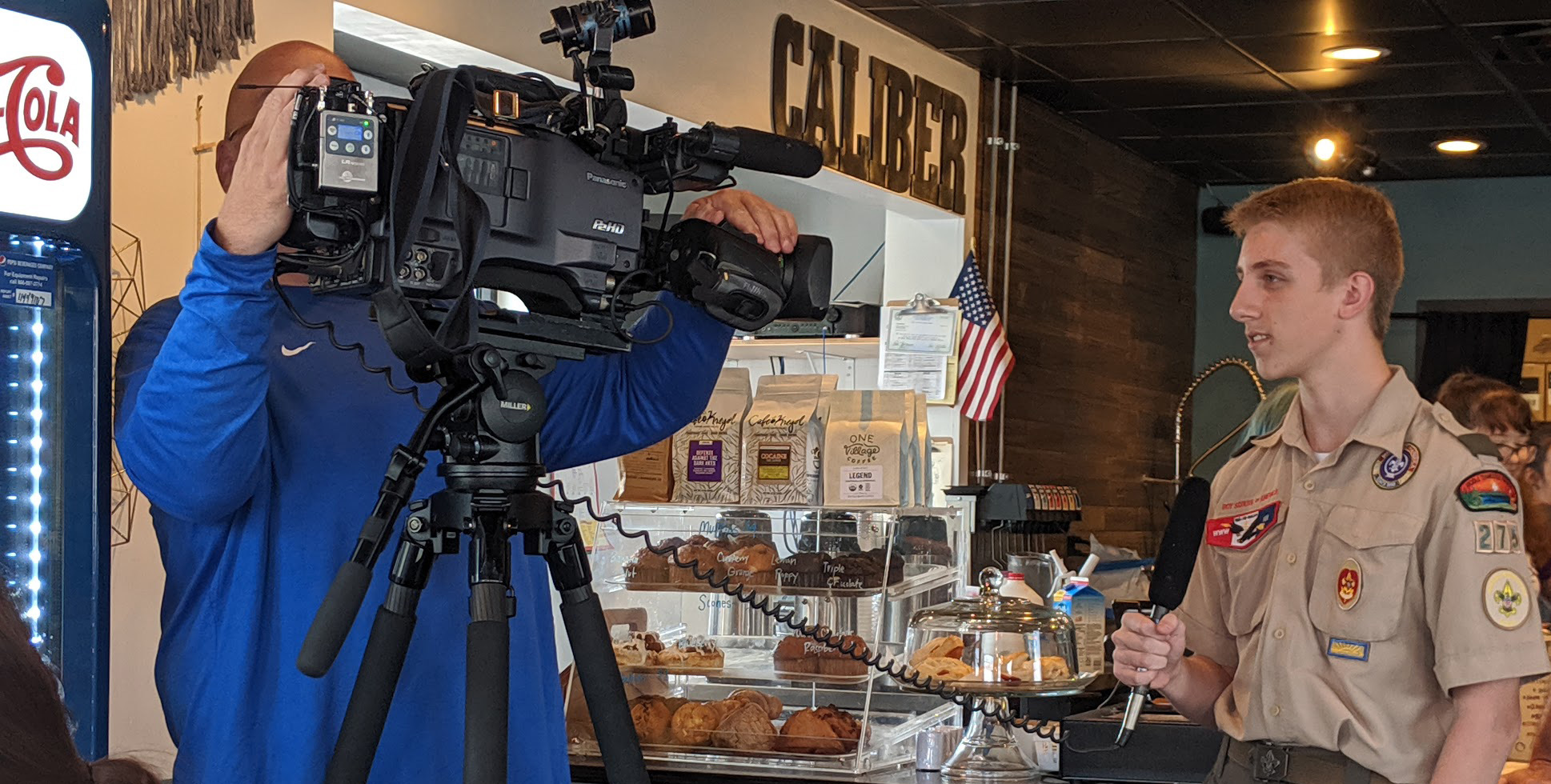 Austin is interviewed at Caliber Coffee in September 2019.