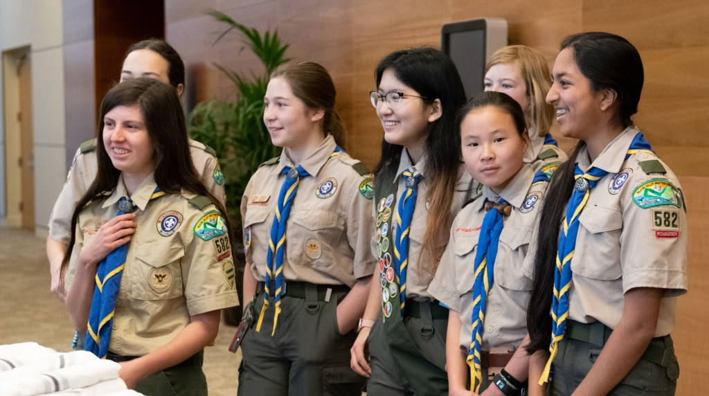 Olivia (left) and her fellow Troop 582 Scouts in 2019.
