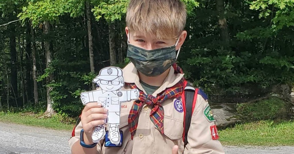 "An Arrow of Light Scout poses with his ""Flat Buxton"" while hiking as part of the Green Mountain Council's monthlong Buxton Hikes the Long Trail project in September."