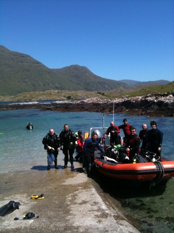 Happy Boat Divers, and Cillian with a Discover Tec participant