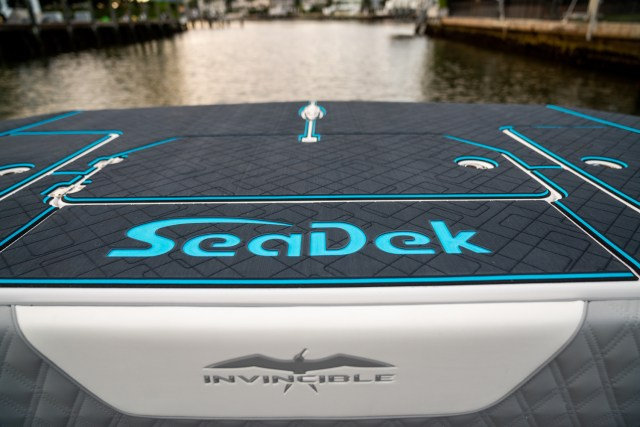 A deck of a 2020 Invincible Catamaran with custom SeaDek in 9mm Dark Gray over Bahama Blue over Midnight Black.